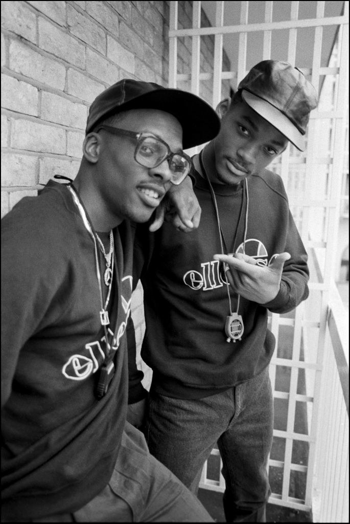 Will Smith (then the Fresh Prince) and DJ Jazzy Jeff posing on a balcony at a Holiday Inn in 1986