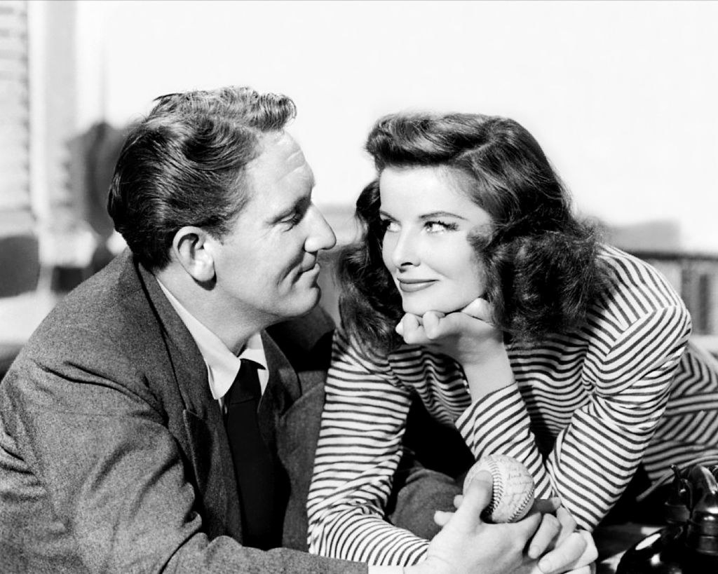 Spencer Tracy and Katharine Hepburn smile at each other