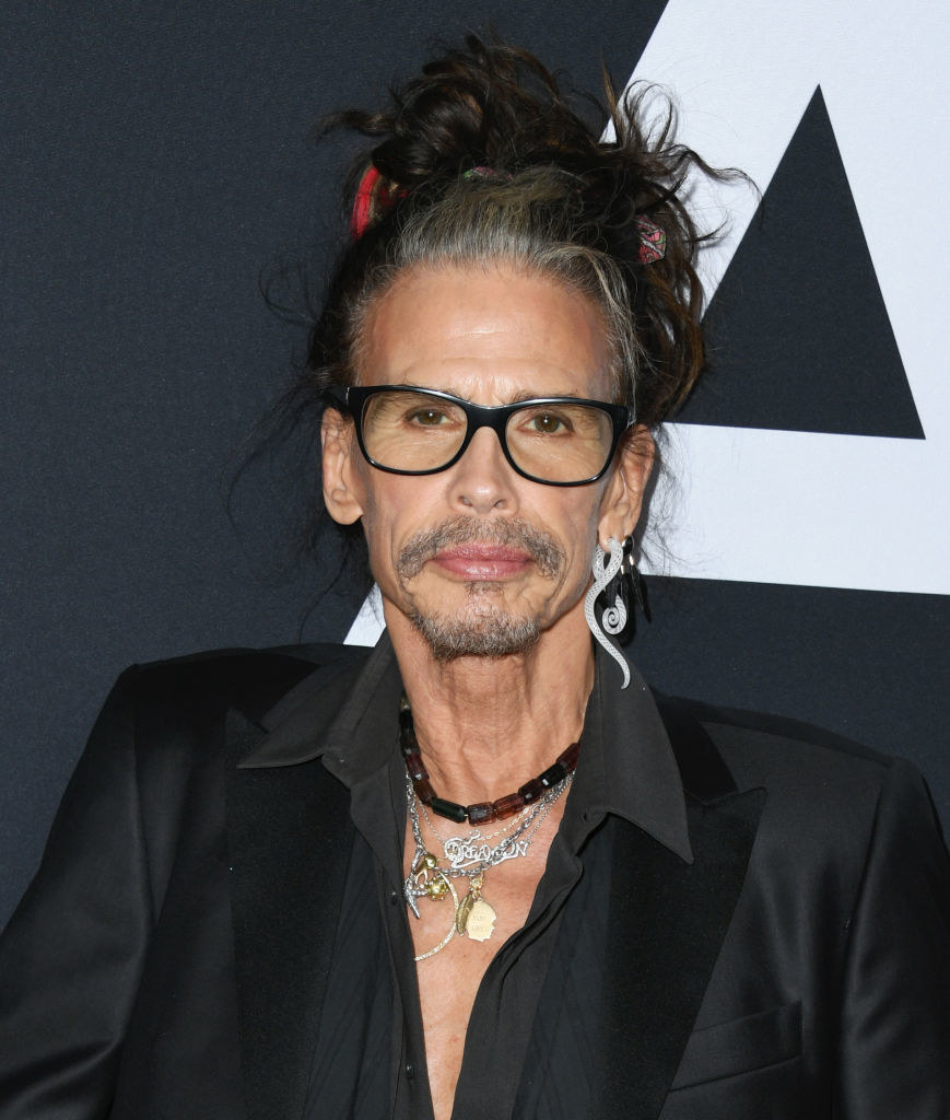 """Steven Tyler at the premiere for """"Ad Astra"""" in 2019, wearing multiple necklaces and a man"""