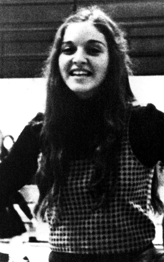 Madonna practicing cheers with long, curly hair in 1972