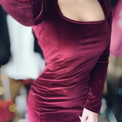 reviewer wearing the wine red dress