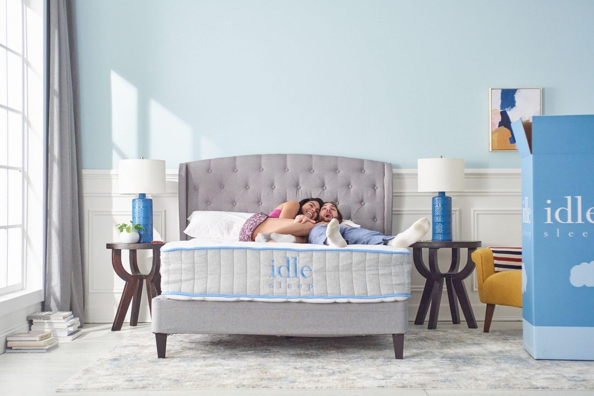 a couple lounging on an idle sleep mattress