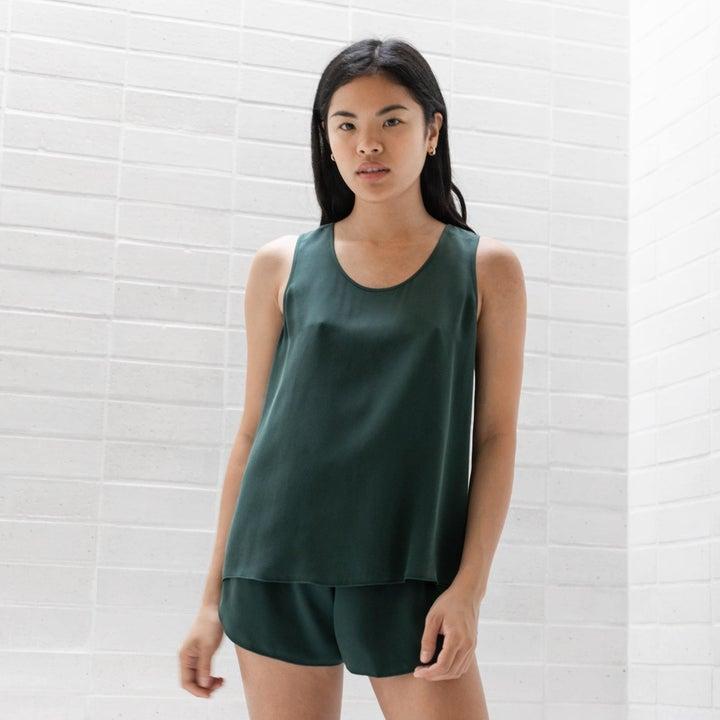 model wearing the green set