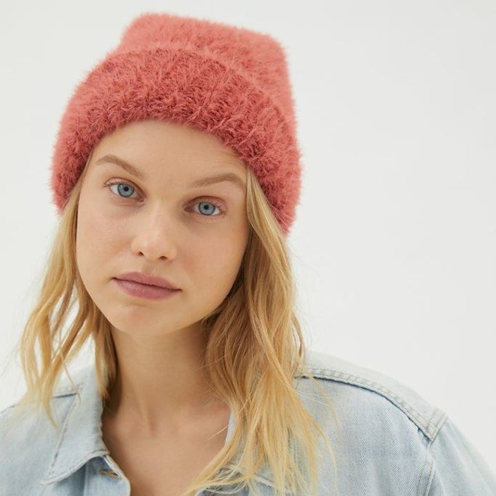 model wearing the pink beanie