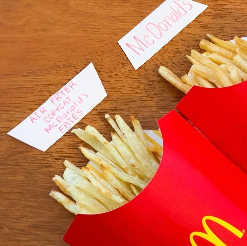 Air fried French fries next to McDonald's fries.