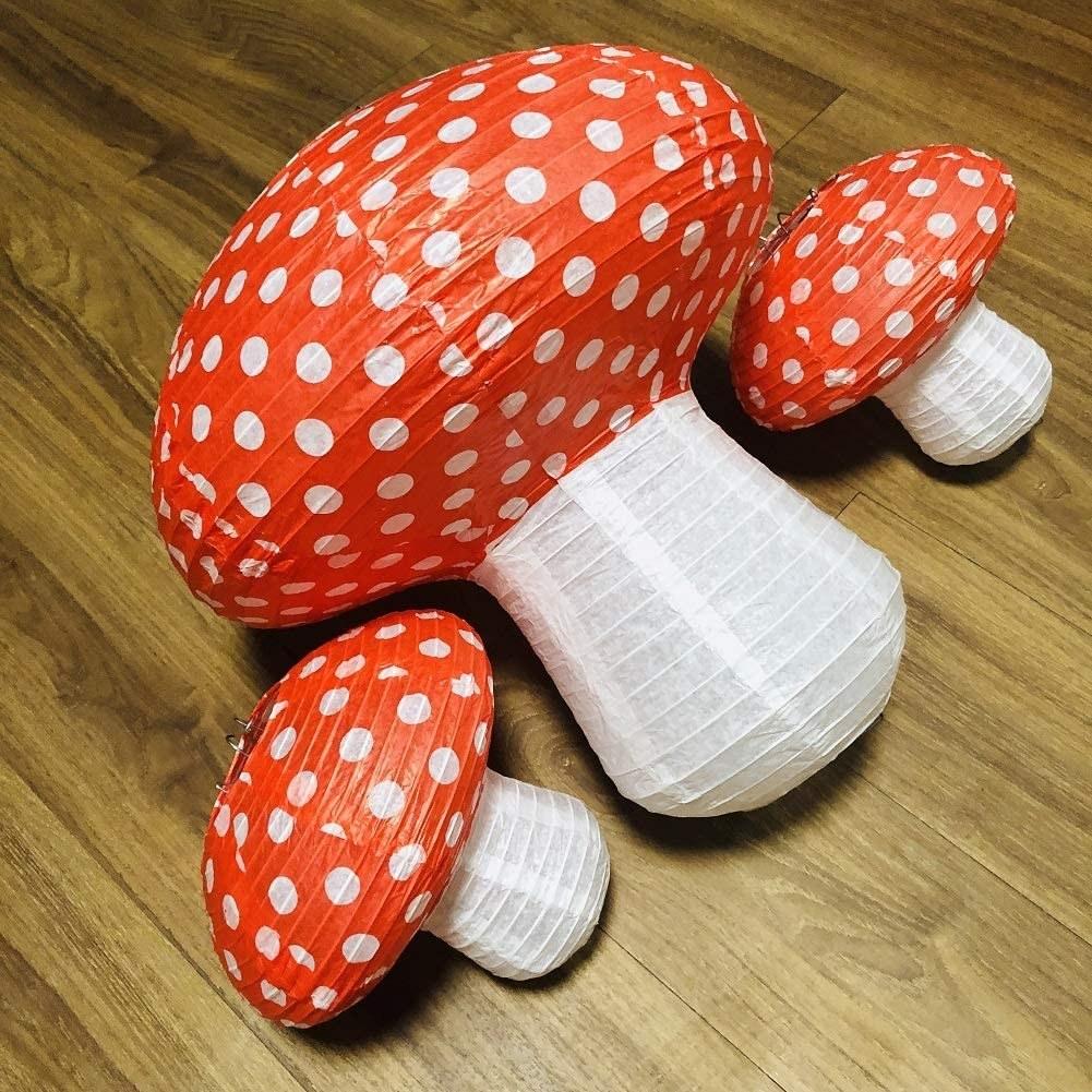 Three red top mushroom lanterns