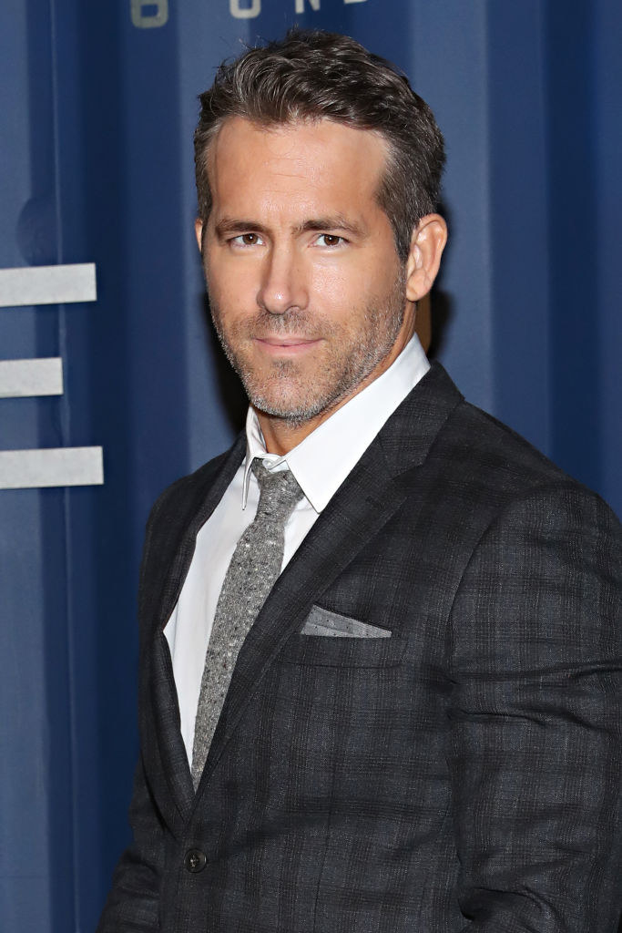 """Ryan Reynolds wearing a suit at the """"6 Underground"""" premiere in 2019"""
