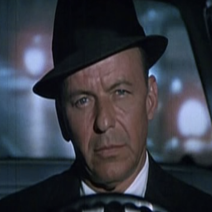 """Frank Sinatra wearing his signature hat while driving a car in """"The Detective"""""""