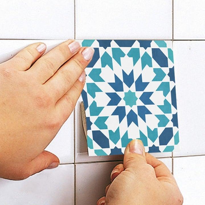 Model applying the sticker to tile