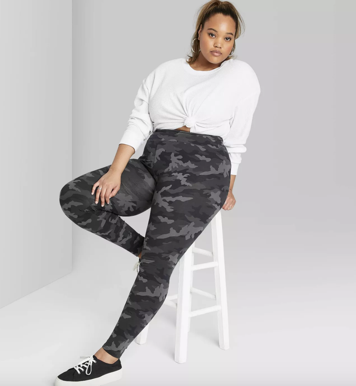 model wearing the camo leggings