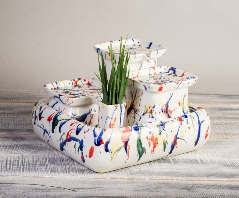 white with splatter paint look sculptural cat fountain