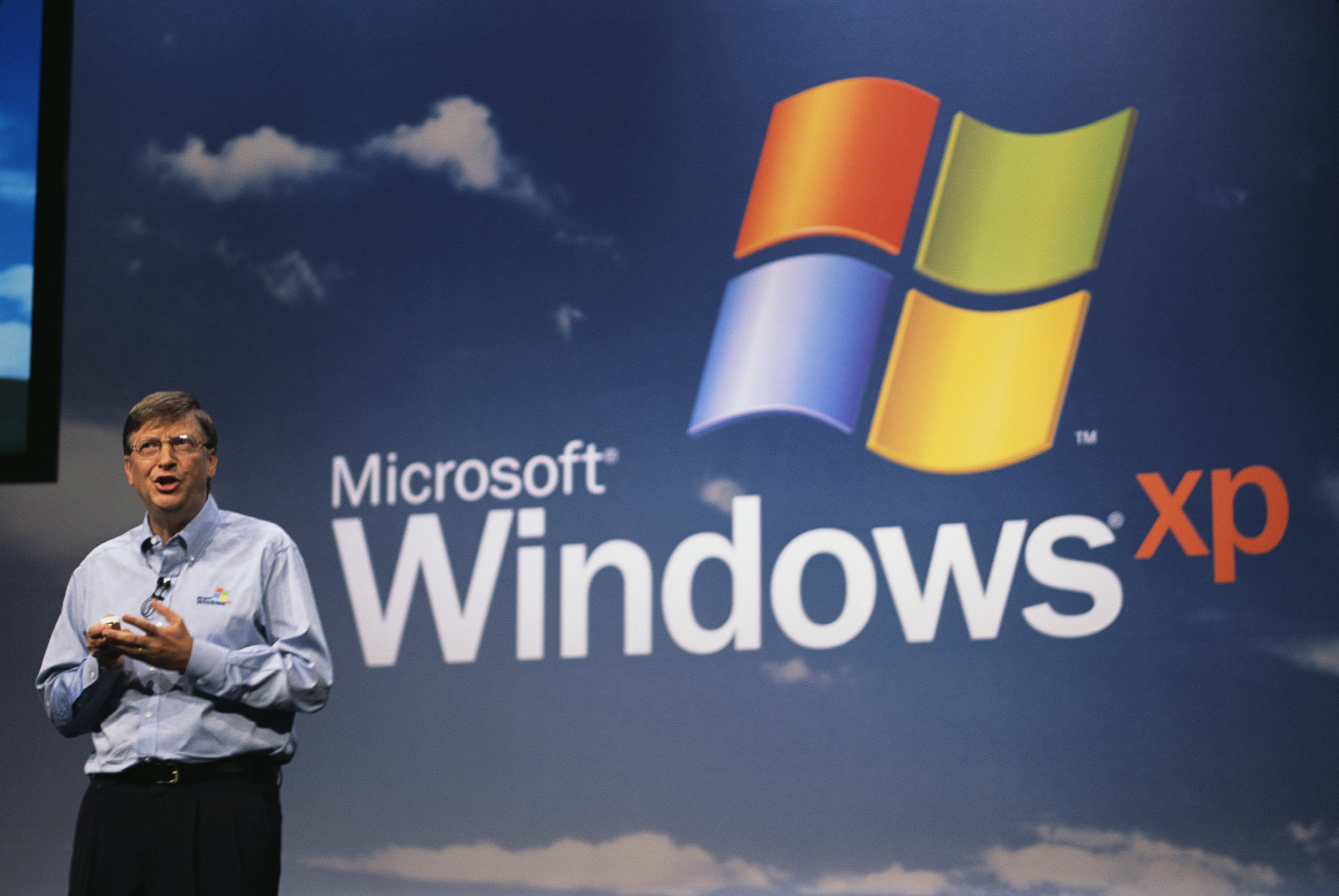 Bill Gates speaking on stage at the launch of Windows XP.