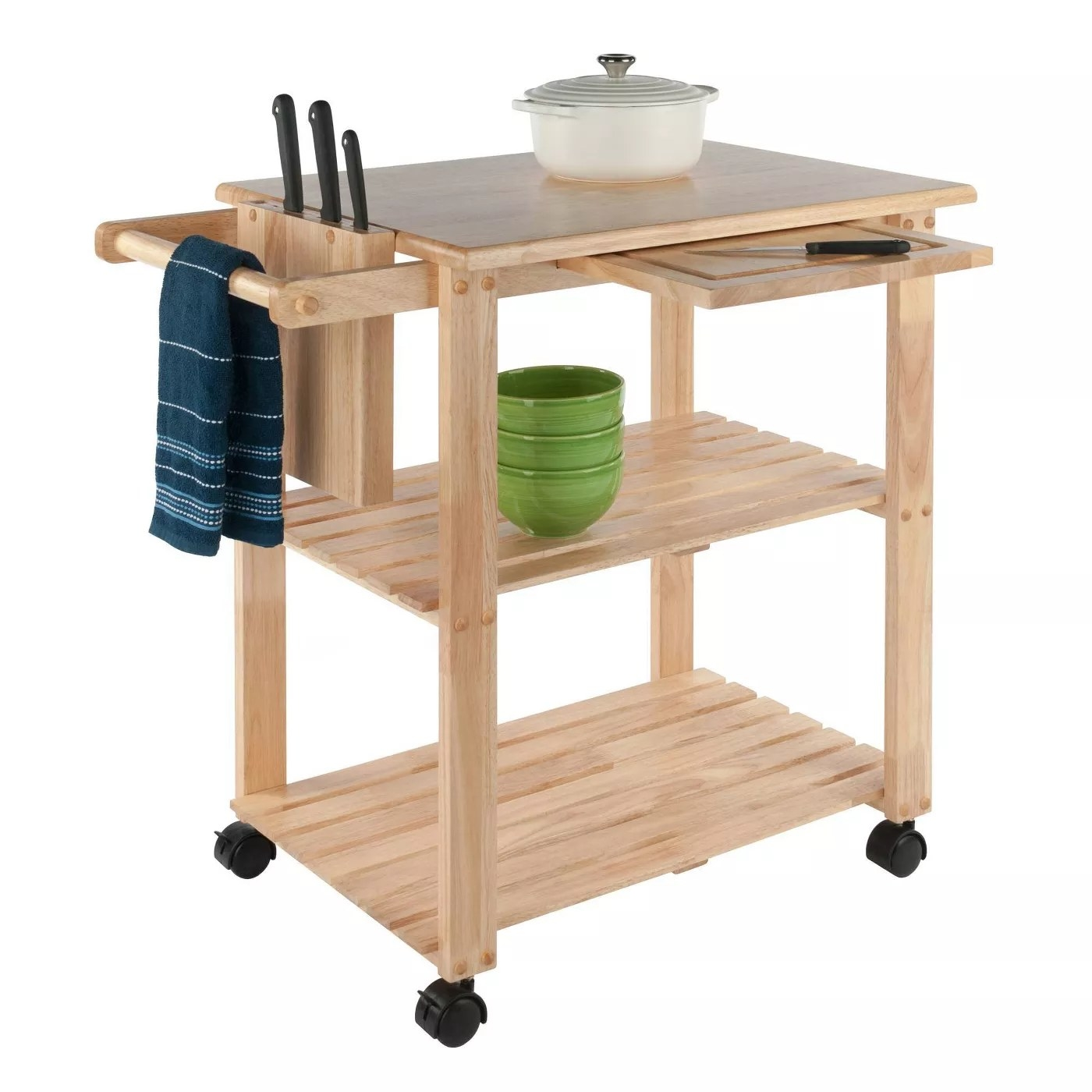 The natural wood kitchen cart with two open shelves and appliances and dishes on it