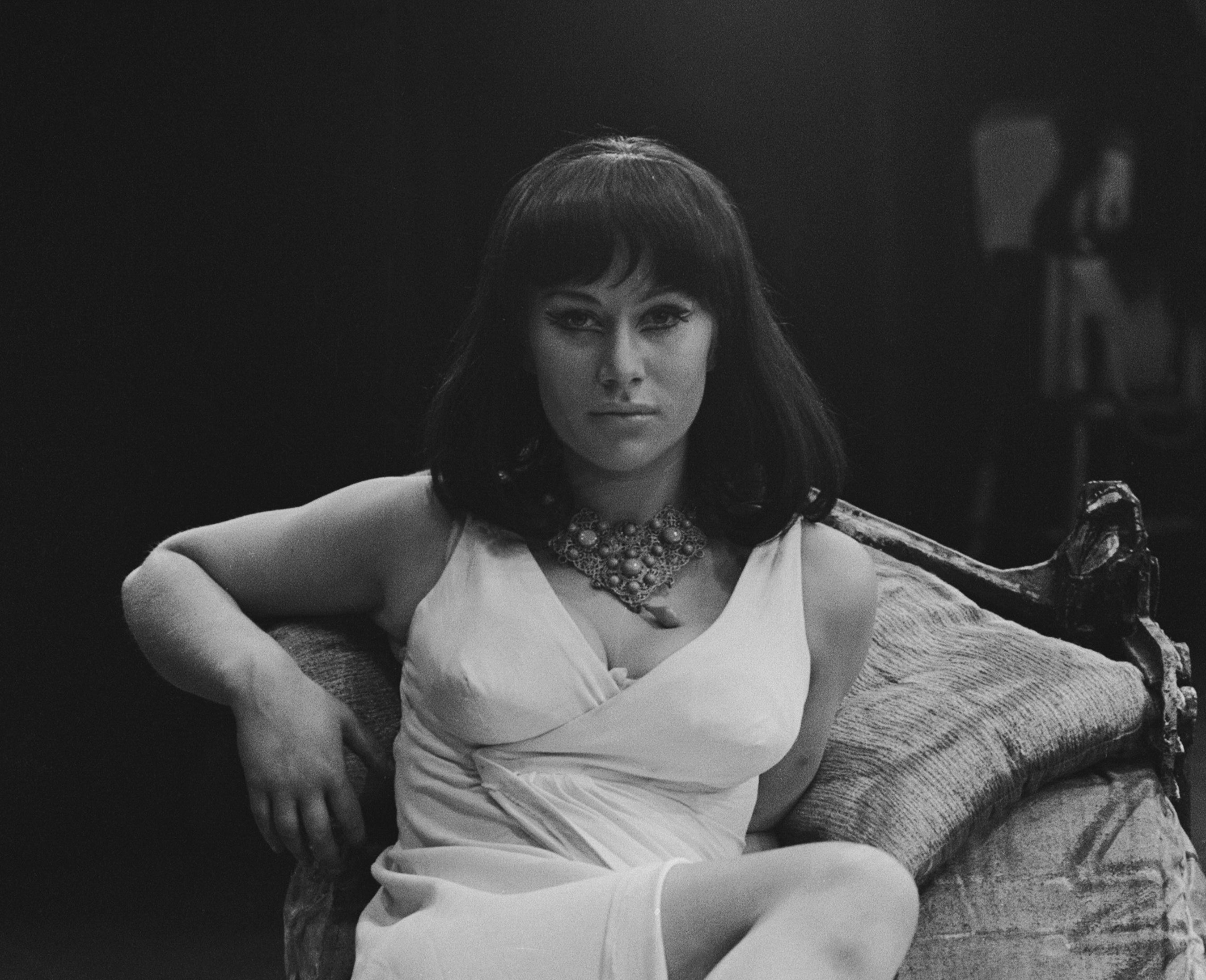 Helen dresses as Cleopatra and laying on a chair