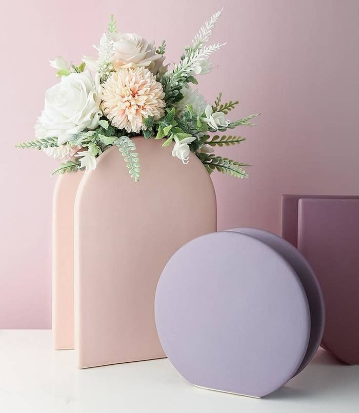 Two of the geometric vases in light purple and pink