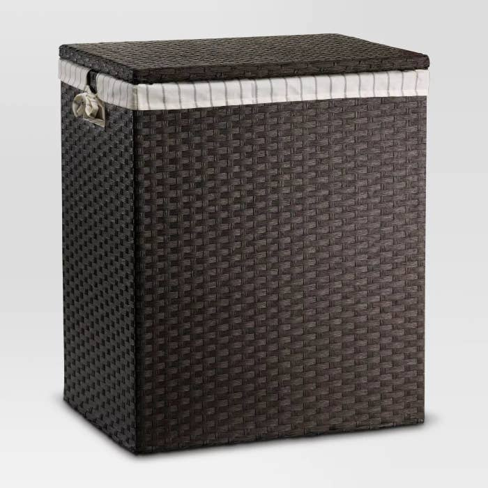 The brown woven hamper with its own lining inside