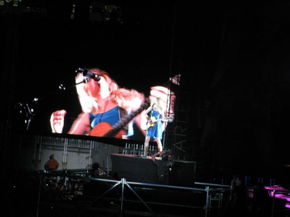 Taylor Swift far away at a concert
