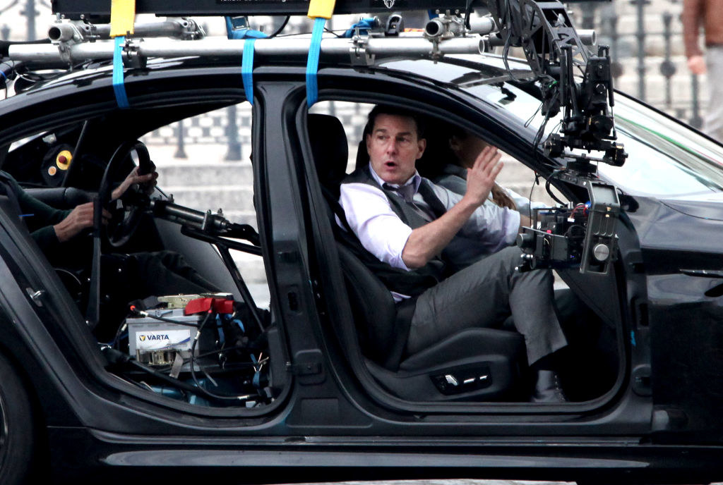 Tom Cruise filming in a car on the set of Mission: Impossible 7