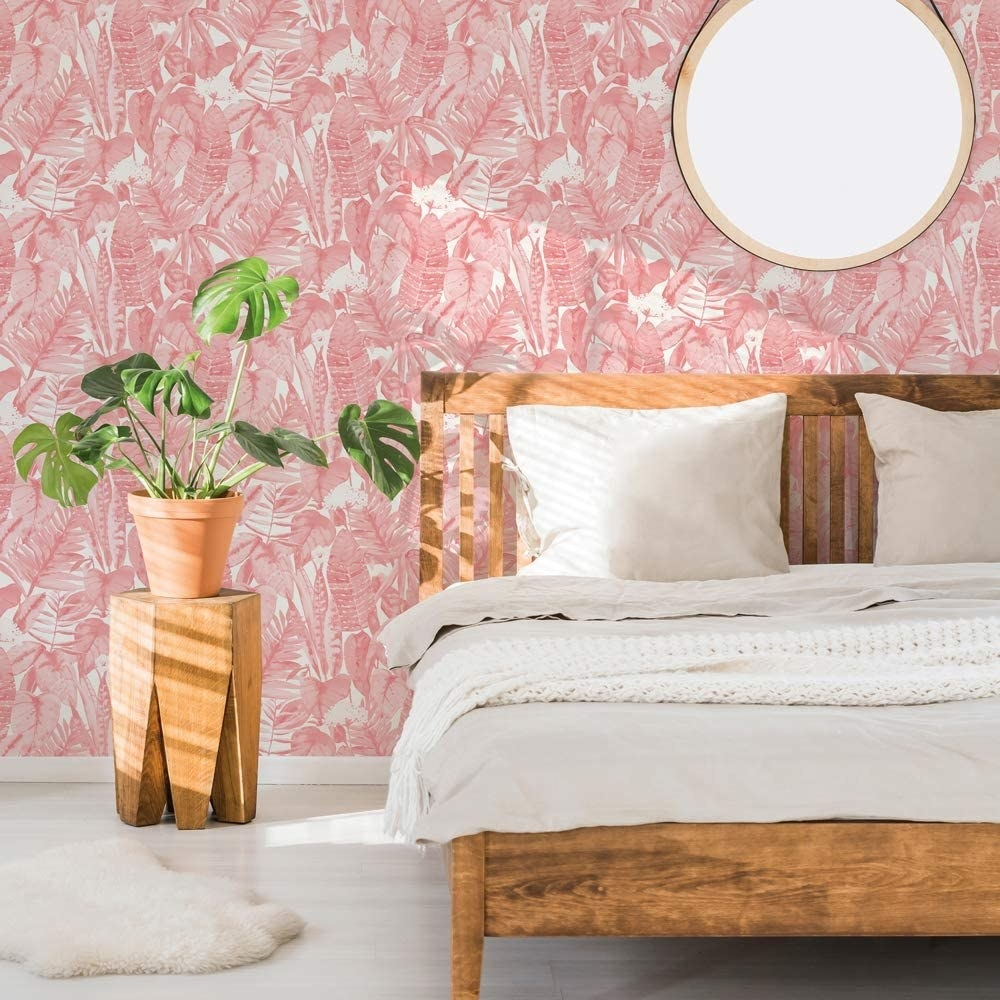 A bedroom with the wallpaper