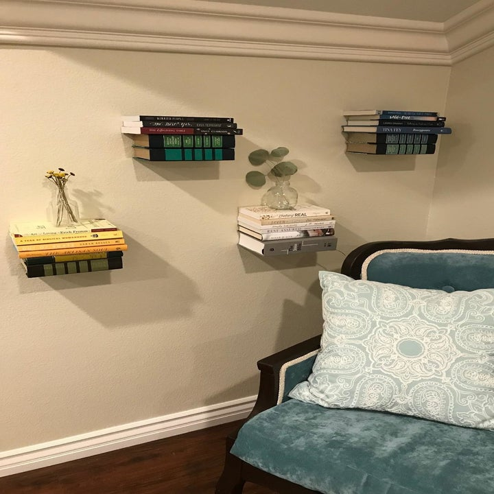 reviewer photo showing floating shelves used to decorate a wall