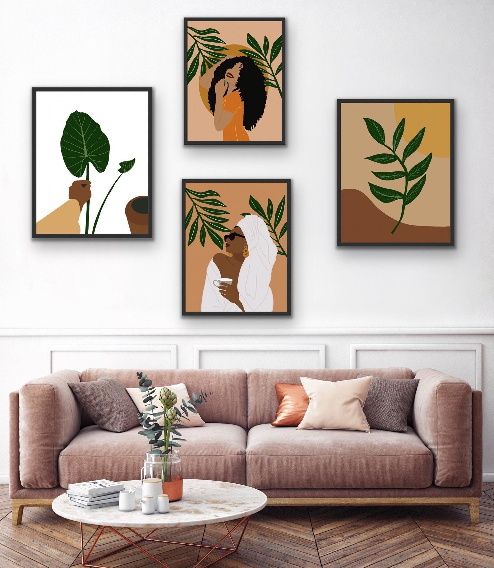 Four prints hanging over a couch