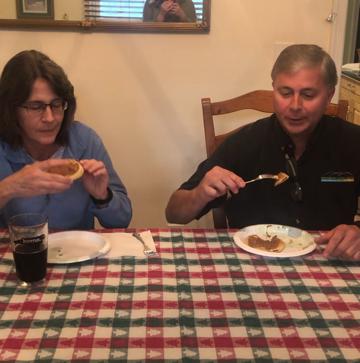 Parents at a table eating waffles