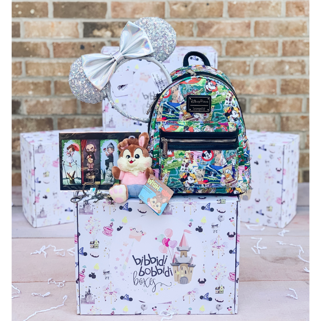the subscription box pictured is their ultimate magic box which includes a Disney plush toy, a loungefly backpack, minnie mouse ears and two other Disney items