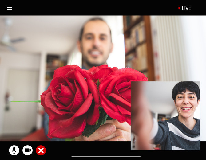 two people video chatting, with one showing roses to the other