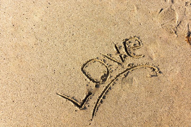 """Love"" written in the sand"