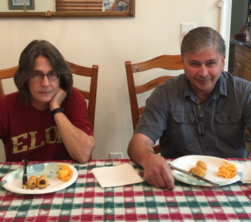 Parents at a table looking disappointed