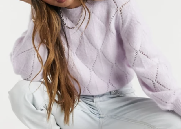A cropped sweater with wavy stitching that makes it look quilted and mom jeas