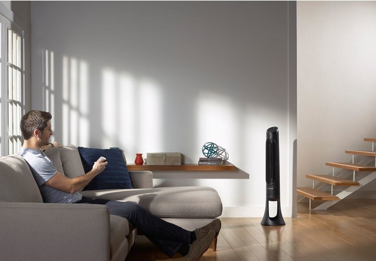 A black tower fan in a living room
