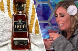 A bottle of 1800 Anjeo Tequilla next to a woman drinking from a glass with a paper umbrella in her hair.