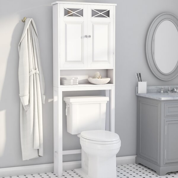 The cabinet, which has two legs that go on either side of the toilet, a shelf above the toilet, and a cabinet with two cabinet doors