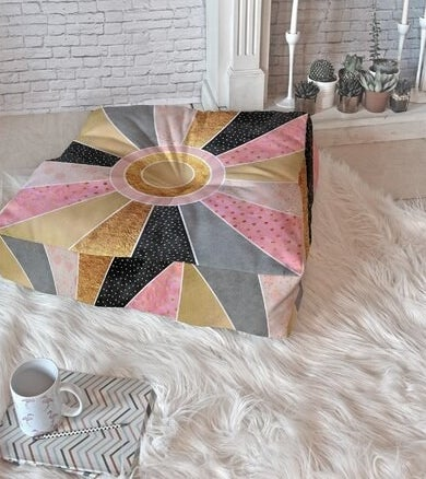 The pillow, which is large, square, and has a patchwork pattern