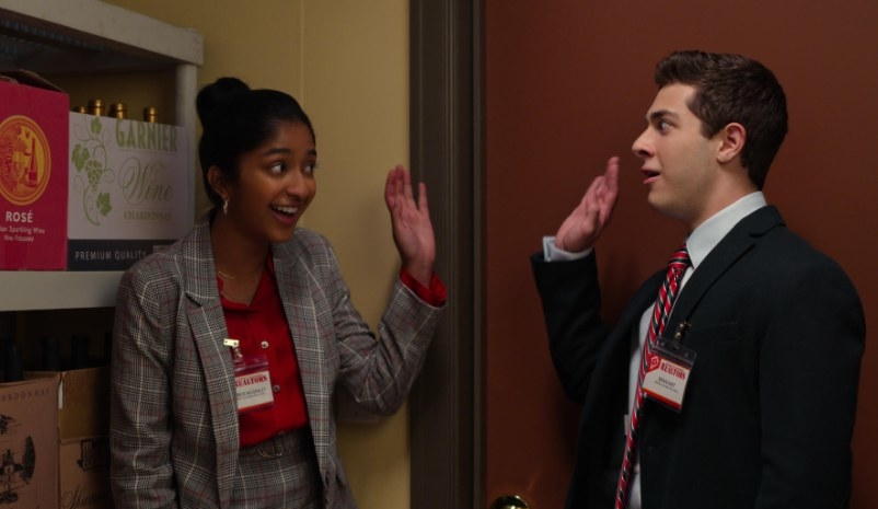 Devi and Ben stand in a closet and raise their hands in front of each other