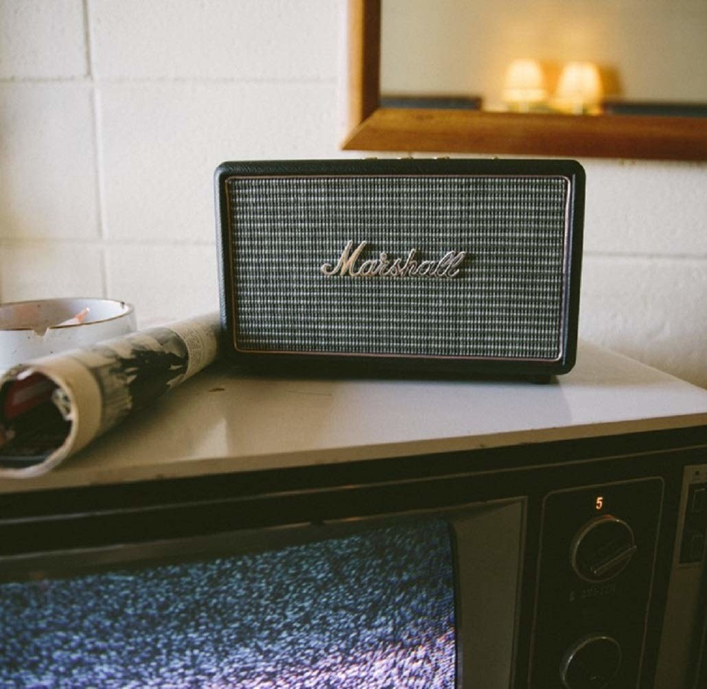 A Marshall Bluetooth speaker on a table