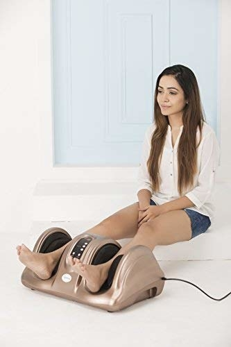 A woman with her feet in a foot massager