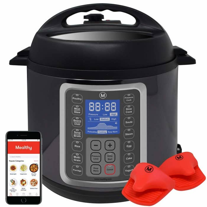 Instant pot with a phone showing the recipes
