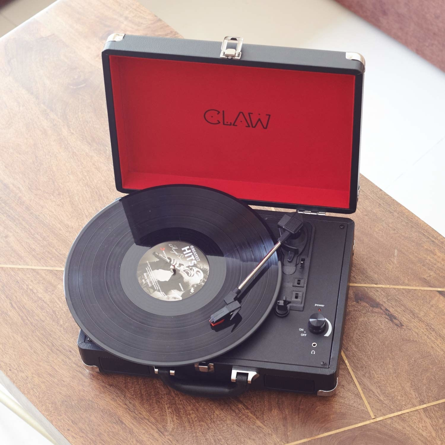 A turntable on a wooden table