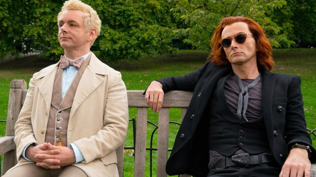 Aziraphale and Crowley sit next to each other on a park bench