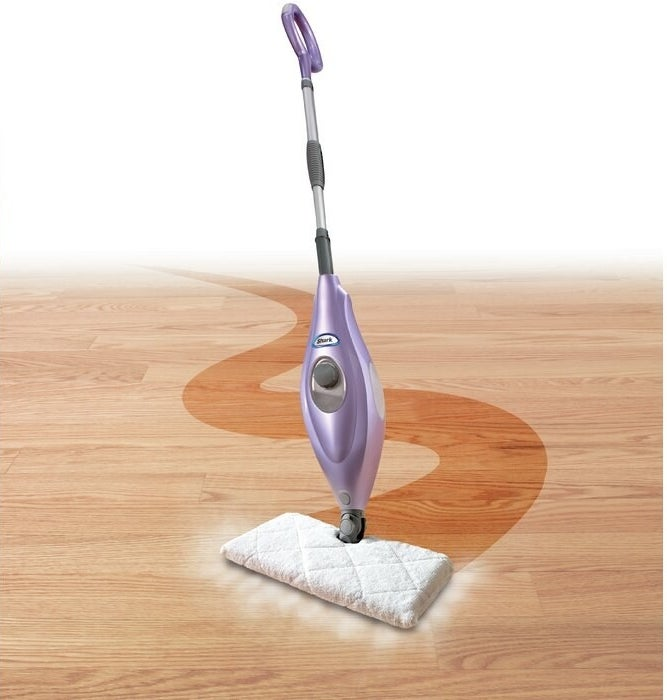 the mop pad cleaning a pathway on a wooden floor