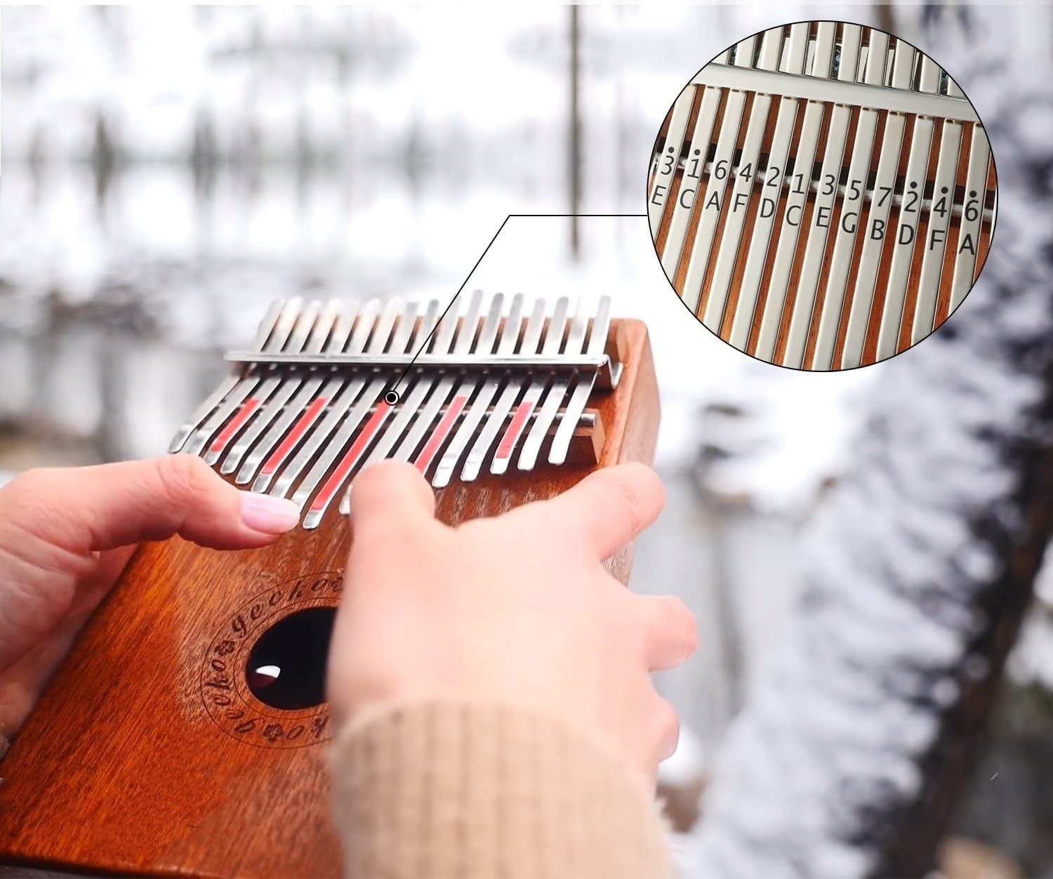 person playing the kalimba