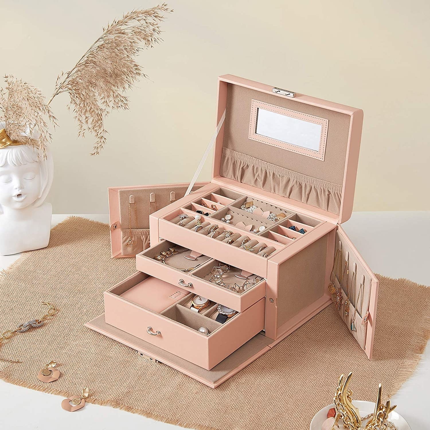 jewelry box with all compartments open showing different types of jewelry