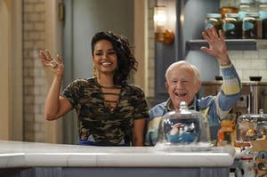 Kyla and Leslie Jordan waving on set in 'Call Me Kat'
