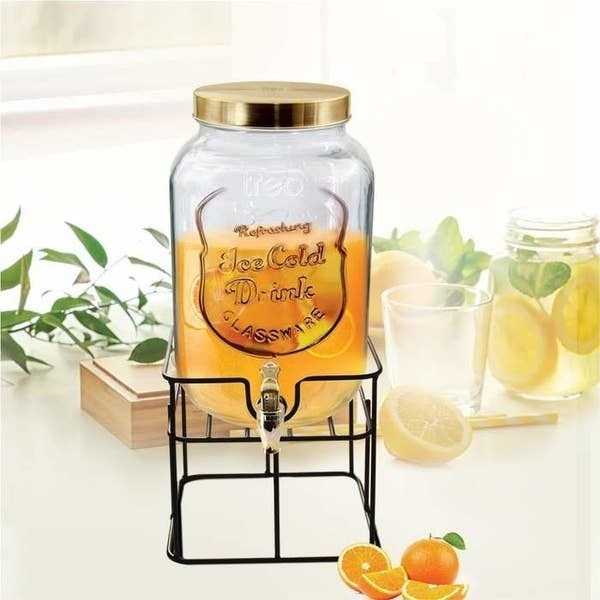 The mason jar dispenser pictured with orange juice.