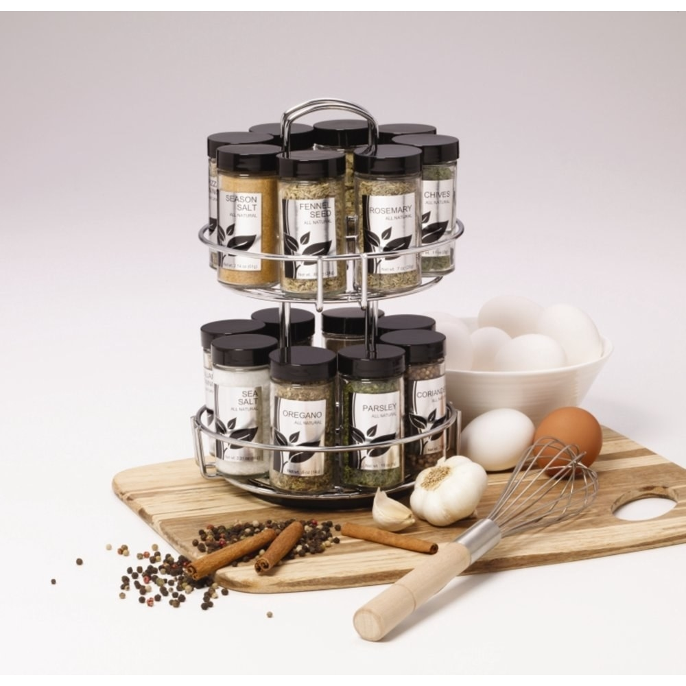 a silver metal rotating spice rack holding sixteen spices