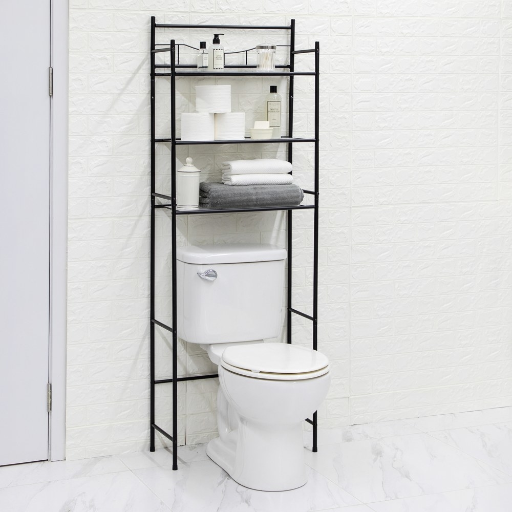 a black metal over the toilet storage rack with three shelves over a toilet in a bathroom
