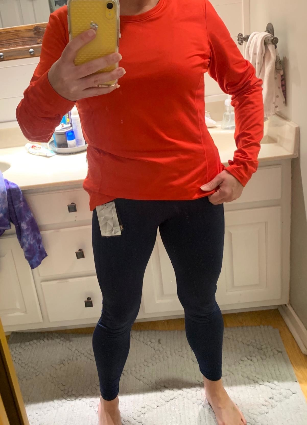 reviewer selfie of them wearing the fleece-lined leggings