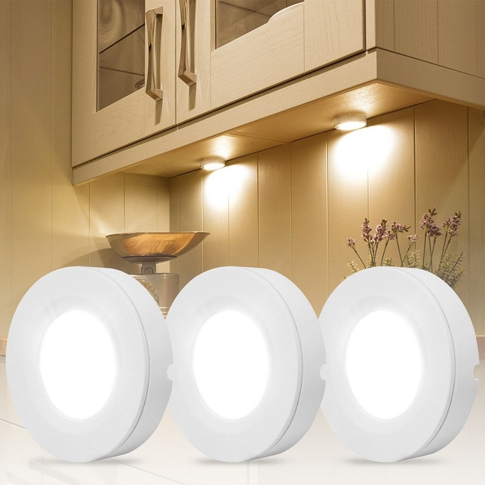 three led lights on display in front of a cabinet that has LED lights adhered under it